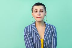 Portrait of crazy handsome beautiful short hair young stylish woman in casual striped suit standing and looking with crossed eyes stock images