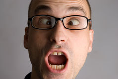 Portrait of crazy man. In glasses stock photo