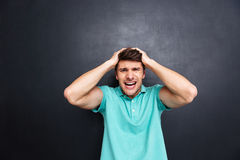 Portrait of a crazy man shouting isolated over black background Stock Photos