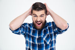 Portrait of a crazy man shouting. On a white background Royalty Free Stock Image
