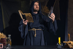 Portrait of a crazy medieval scientist working in his laboratory. Stock Photos