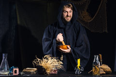 Portrait of a crazy medieval scientist working in his laboratory. Royalty Free Stock Photo