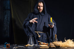 Portrait of a crazy medieval scientist working in his laboratory. Royalty Free Stock Photography