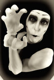 Portrait of the crazy mime. In white gloves royalty free stock image