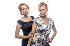 Portrait of crazy sisters on white background Stock Image