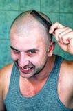 Crazy bald man with black comb stock image
