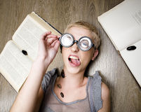 Portrait of crazy student in glasses with books and cockroaches Stock Photo