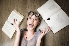 Portrait of crazy student in glasses with books and cockroaches Royalty Free Stock Image