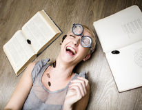 Portrait of crazy student in glasses with books and cockroaches Royalty Free Stock Photos