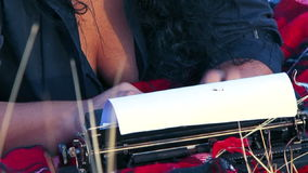 Portrait of Crazy Typing On Press Machine. Two frames: in first - hands of a woman typing something on a sheet of paper with a help of press machine, in the stock video footage