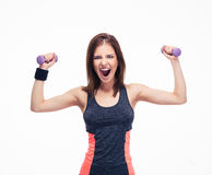 Portrait of a crazy woman with dumbbells Royalty Free Stock Image