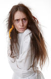 Portrait of a crazy woman in a straitjacket Stock Images