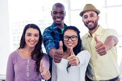 Portrait of creative business people showing thumbs up Royalty Free Stock Image