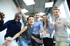 Portrait of creative business team standing together and laughing. Multiracial business people together at startup. Stock Image