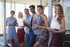 Portrait of creative business team using technologies at office Stock Image