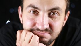 Young male with beard and mustache close up face of european guy casual man in good positive mood looks and smiles. Portrait of creative young male with beard stock video footage