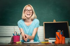 Portrait of creative young smiling female Student in glasses. Smiling girl student or woman teacher portrait on green