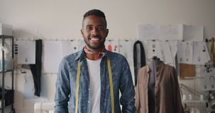 Portrait of creative young tailor African American man smiling in studio stock footage
