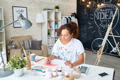 Young Woman Painting at Home stock images