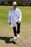 Portrait of cricket umpire signaling leg bye on sunny day Stock Photo