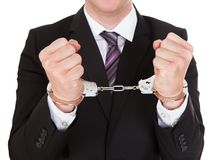 Portrait of criminal businessman. Isolated over white background Royalty Free Stock Photography