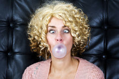 Portrait of cross-eyed blond woman with bubblegum Stock Images