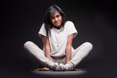 Portrait of a crouched indian girl Royalty Free Stock Photos