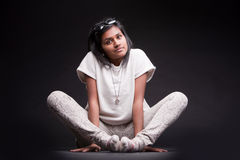 Portrait of a crouched indian girl Stock Image