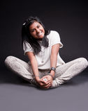 Portrait of a crouched indian girl Stock Photos