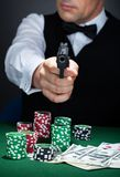 Portrait of a croupier aiming with a gun Royalty Free Stock Photos