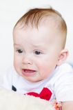 Portrait of the crying baby Stock Images
