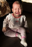 Portrait of a crying baby. The baby cries Royalty Free Stock Images