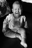 Portrait of a crying baby. The baby cries Stock Image