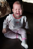 Portrait of a crying baby. The baby cries Royalty Free Stock Photos