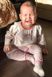 Portrait of a crying baby. The baby cries Royalty Free Stock Photo