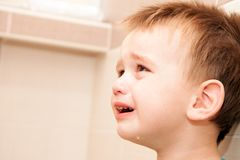 Portrait Of Crying Baby Boy In Home Royalty Free Stock Photography