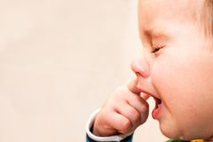 Portrait Of Crying Baby Boy In Home Stock Photos