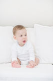 Portrait of crying baby boy in white. Little Angel Stock Image