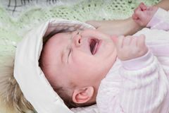 Portrait of a crying baby Royalty Free Stock Images