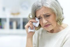 Crying elderly woman Stock Photos