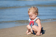 Portrait of crying girl in swimsuit on beach Royalty Free Stock Images