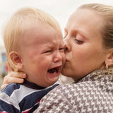 Portrait of a crying little boy who is being held  Royalty Free Stock Photo