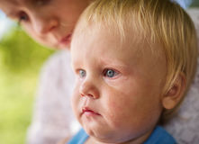 Portrait of a crying little boy who is being held  Royalty Free Stock Photos