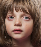 Portrait of a crying little girl Stock Photo