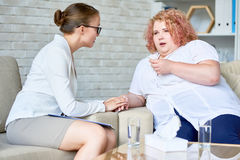 Obese Young Woman  Discussing Depression with Psychiatrist Royalty Free Stock Image