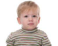 Portrait of a crying toddler. A blond handsome toddler is crying; isolated on the white background royalty free stock photos