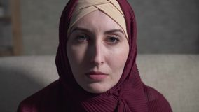 Portrait of a crying young muslim woman. In a traditional scarf stock video