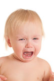 Portrait of crying young sitting baby Royalty Free Stock Photography