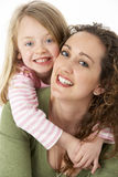 Portrait Of Cuddling Mother And Child Royalty Free Stock Image