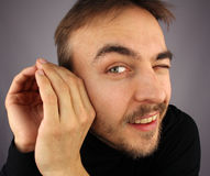 Portrait of cunning man, that  listens carefully Stock Photography